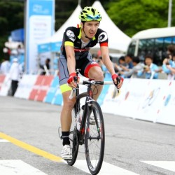 OCBC Singapore Pro Cycling Team rider Eric Sheppard crosses the finish line in Stage 3 of the Tour de Korea on Tuesday in Yeongju, Korea.
