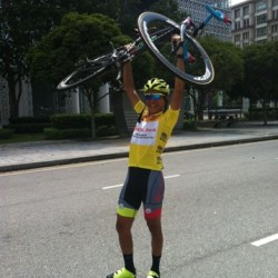 OCBC Singapore Pro Cycling Team rider Loh Sea Keong celebrates winning the yellow jersey at Jelajah Malaysia after Stage 5 of the race on Sunday in Putrajaya, Malaysia.