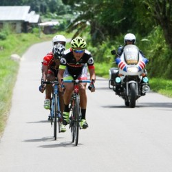 OCBC Singapore Pro Cycling Team rider Loh Sea Keong (front) competes in Stage 4 of the Tour de Singkarak on 5 June 2013 in Pulau Punjung, Indonesia.