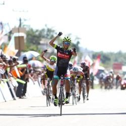 OCBC Singapore Pro Cycling Team rider Loh Sea Keong (front) celebrates winning Stage 4 of the Tour de Singkarak on 5 June 2013 in Pulau Punjung, Indonesia.