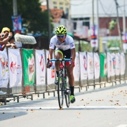OCBC Singapore Pro Cycling Team rider Loh Sea Keong (front) crosses the finish line in third place in Stage 2 of Jelajah Malaysia on Thursday in Batu Pahat, Malaysia. Following closely behind Loh is fellow OCBC Singapore Pro Cycling Team rider Jason Christie (back).