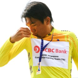OCBC Singapore Pro Cycling Team rider Loh Sea Keong celebrates wearing the yellow jersey awarded to the overall General Classification leader after Stage 3 of Jelajah Malaysia on Friday in Pontian, Malaysia.
