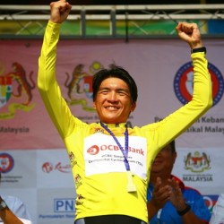 OCBC Singapore Pro Cycling Team rider Loh Sea Keong celebrates wearing the yellow jersey awarded to the overall General Classification leader after Stage 2 of Jelajah Malaysia on Thursday in Batu Pahat, Malaysia.