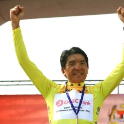 OCBC Singapore Pro Cycling Team rider Loh Sea Keong celebrates wearing the yellow jersey after Stage 4 of Jelajah Malaysia on Saturday in Malacca, Malaysia.