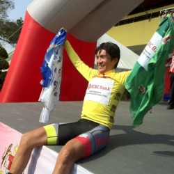 OCBC Singapore Pro Cycling Team rider Loh Sea Keong celebrates wearing the overall General Classification leader's yellow jersey, while also  holding the green, blue and white jerseys after Stage 2 of Jelajah Malaysia on Thursday in Batu Pahat, Malaysia.