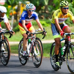 OCBC Singapore Pro Cycling Team rider Loh Sea Keong (right) competes in Stage 3 of Jelajah Malaysia on Friday in Pontian, Malaysia.